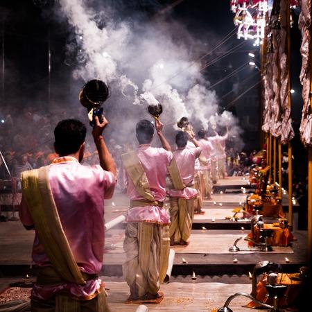 Group of priests performing Aarti - Hindu religious ritual of wo