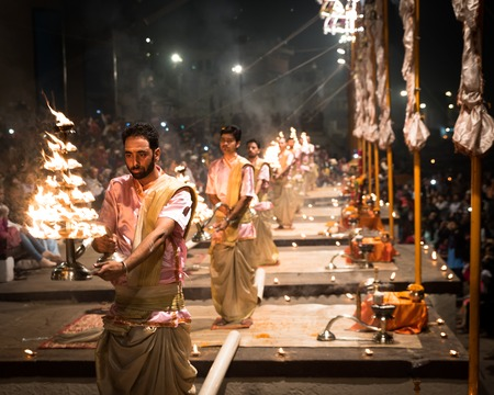 Group of priests performing Aarti - Hindu religious ritual