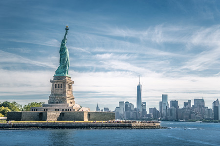 liberty torch: The statue of Liberty and Manhattan, New York City