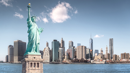 The statue of Liberty, Landmarks of New York City with Manhattan building background Zdjęcie Seryjne - 79128785