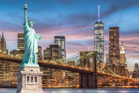 The Statue of Liberty and Brooklyn Bridge with World Trade Center background twilight sunset view, Landmarks of New York City, USA