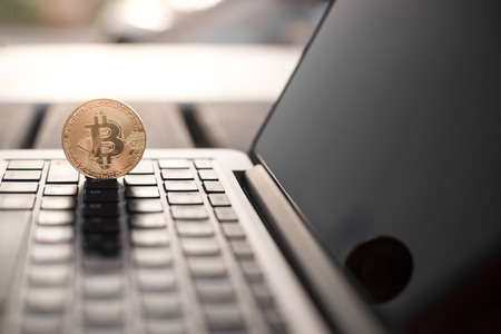 Bitcoin coin symbol on laptop, future concept financial currency, crypto currency sign Zdjęcie Seryjne