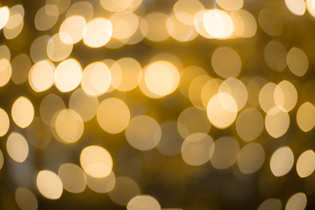 Golden bokeh blurred abstract background at night