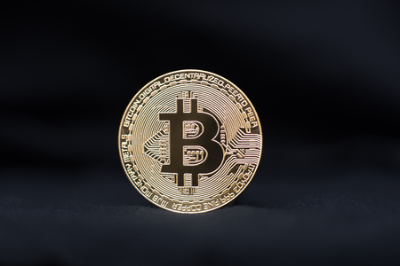 Bitcoin physical coin symbol on black background, blockchain future concept financial currency, crypto currency sign
