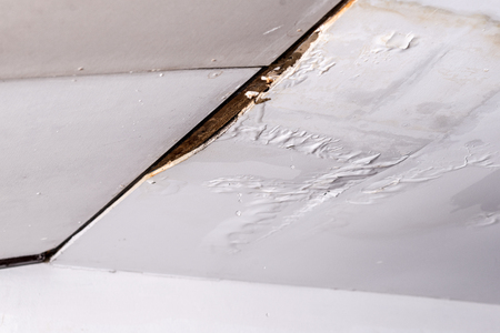 Damaged ceiling from water leak in rainy season