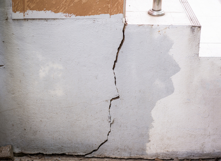 Cracked wall, damaged concrete house base