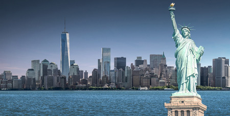 The Statue of Liberty with high-rise building in Lower Manhattan background, Landmarks of New York City, USA