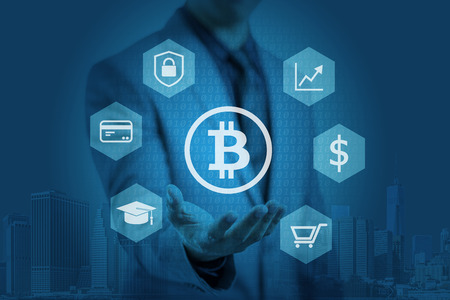 Businessman is showing bitcoin graphic on hands, concept of blockchain technology Zdjęcie Seryjne