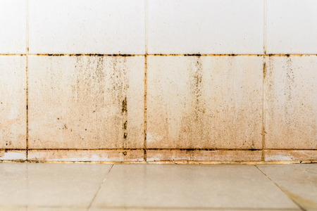 Dirty on ceramic wall in bathroom