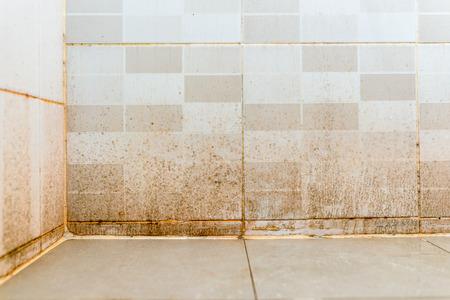 Dirty on ceramic wall in bathroom