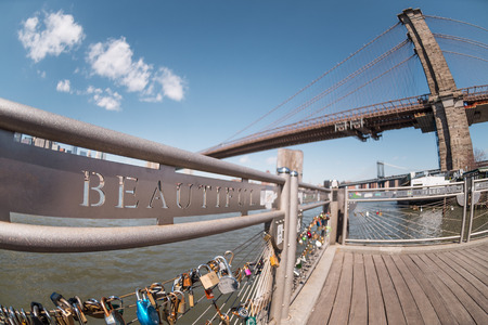 Selective focus on Beautiful word and love locks terrace with blurred Brooklyn bridge background in New York City, USA