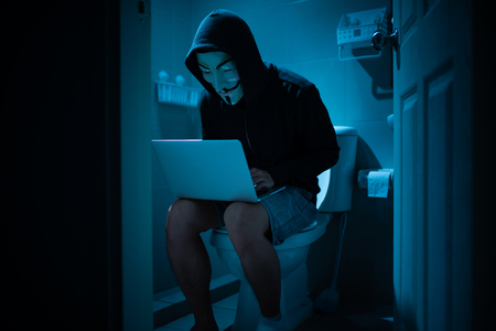 Hacker sit on the toilet, concept of everywhere can hack Zdjęcie Seryjne