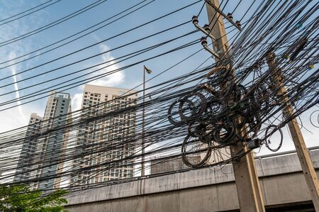 Jumble of overhead electricity and communication cables in Thailand Zdjęcie Seryjne