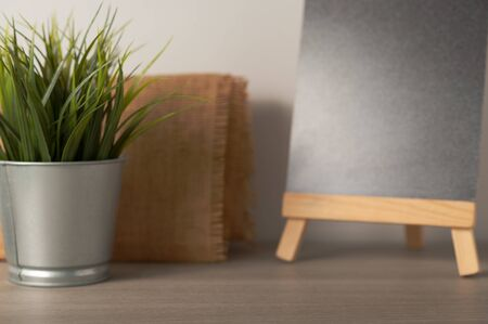 Minimal blurred background for present product on the table with flower pot and blackboard