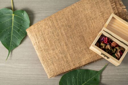 Top view minimal blurred background for present product on the table with leaves and mat Zdjęcie Seryjne - 146527644