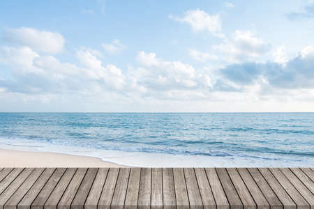 Wooden walkway with beautiful white sand beach ocean and clear blue sky background, space for product or object presentation