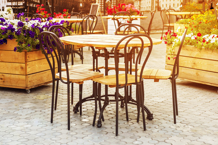 Cafe with tables and chairs in street Banco de Imagens