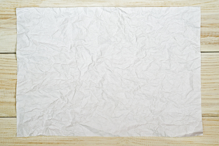 Paper crumpled of empty and copy space on wooden background Stock Photo