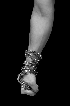 Fist of man in chains. Black and white Imagens