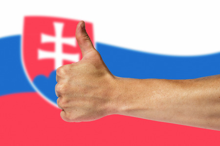 Thumbs up on a background of a flag of Slovakia