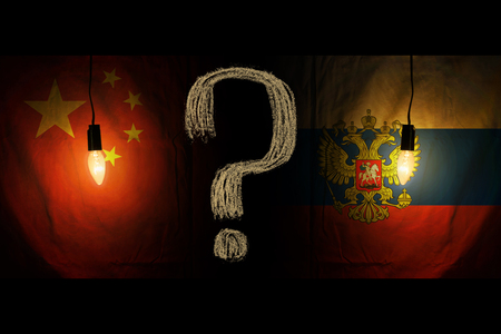 Russian and Chinese flags. Relations between the countries. that is hidden. Stock Photo