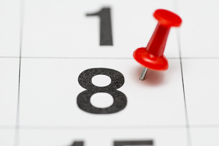 Pin on the date number 8. The eighth  day of the month is marked with a red thumbtack. Pin on calendar