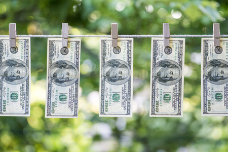 Money Laundering. Money Laundering US dollars hung out to dry. 100 dollar bills hanging on clotheslines