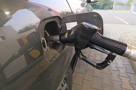 Car refueling on a petrol station. Refill and filling oil gas fuel at station.Gas station - refueling.To fill the machine with fuel. Car fill with gasoline at a gas station