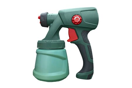 Spray gun for painting a hand-held electric tool. Industrial spray gun for painting isolated on white background. The tool for a painting of surfaces - spray gun