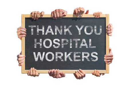 """A lot of hands are holding a poster with the inscription """"Thank you hospital workers"""". Concept of gratitude to medical workers during the coronavirus pandemic"""