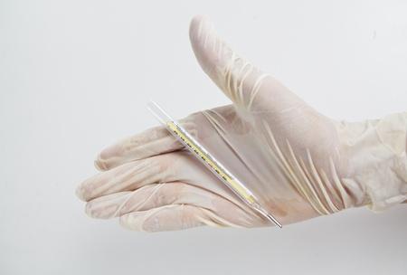 Put gloves on mercury temperature. photo