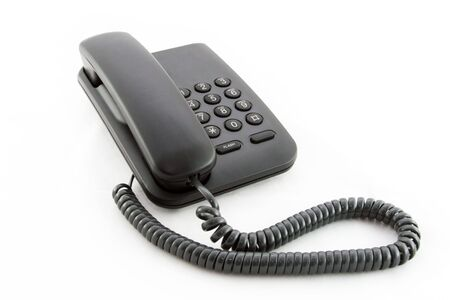 touchtone: Black office telephone on a white background.
