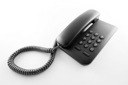 Black office telephone on a white background. Stock Photo - 3630402