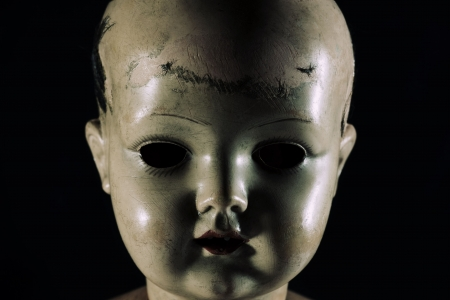 Scary doll face Stock Photo