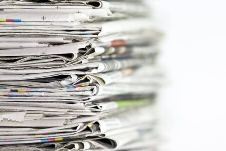 periodical: Pile of newspapers on white background