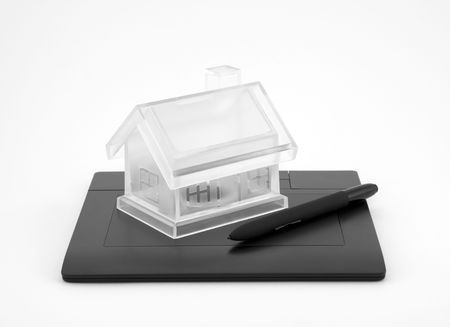 Design new house. Digital tablet and crystal house. photo