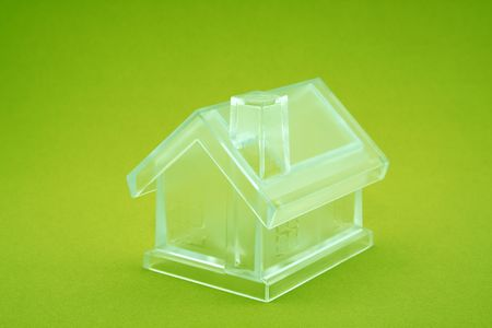 simply: Crystal house on green background