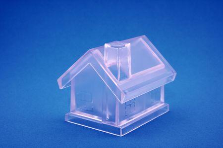 Crystal house on blue background Stock Photo