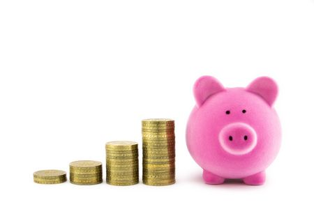 Pink piggy bank and coins photo