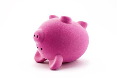 Pink piggy bank upside down photo
