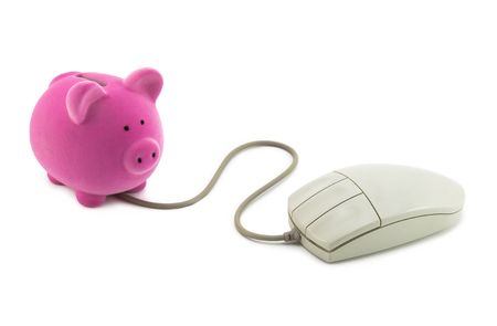Piggy bank with computer mouse.  photo