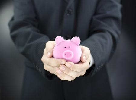 Man holding piggy bank photo