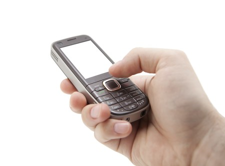 Mobile phone in hand  Stock Photo - 7801585