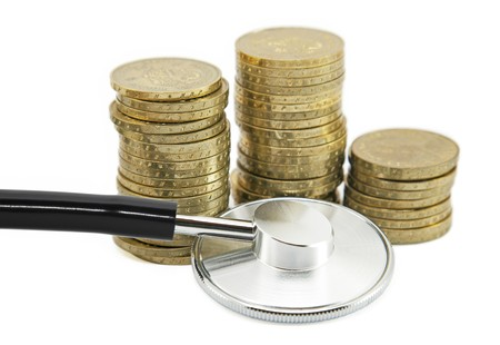 Financial health. Stethoscope with coins photo