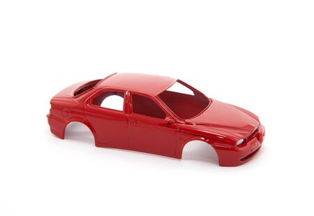 Red toy car body on white background Stock Photo - 8384043