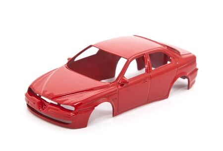 Red toy car body on white background Stock Photo - 8384002