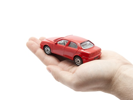 Hand holding a small red car.  Stock Photo