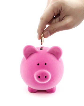 money box: Putting coin into the piggy bank Stock Photo