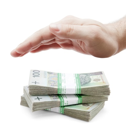 Polish money and hand on white Stock Photo