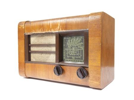 Old wooden radio isolated on white photo